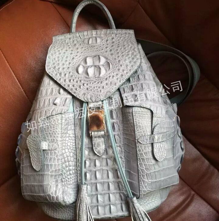 鳄鱼皮皮包厂商出售-如皋市海宏皮革制品为您提供口碑好的鳄鱼皮皮包