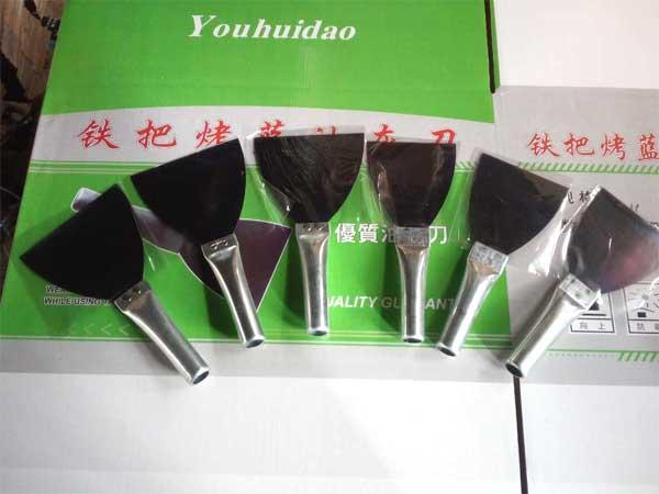 临沂裕锦工具提供有品质的铁把烤蓝油灰刀,广东油灰刀批发