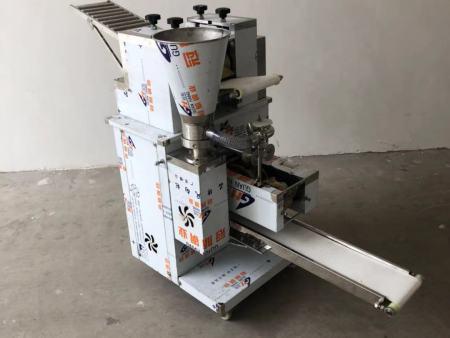 山西全自动饺子机好用吗?河北金豪棋牌安卓版机械厂价格便宜