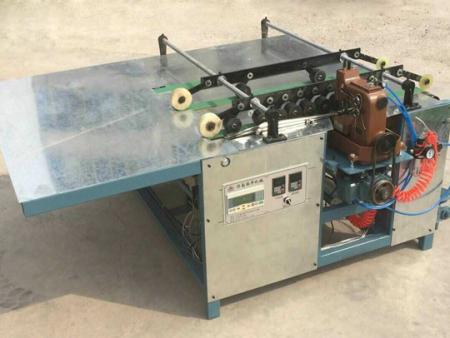 吉林编织袋自动缝底机|遵义华信包装机械编织袋切缝印收一体机行情价格