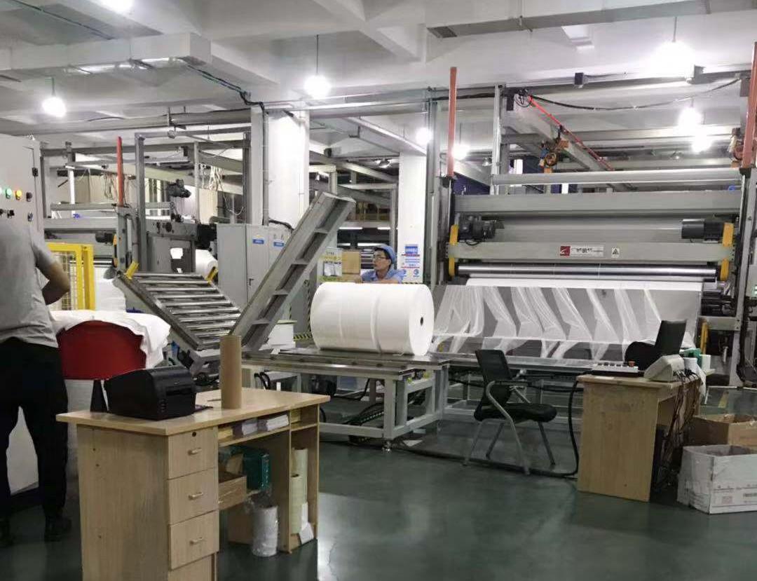 龙岩无纺布自动称重缠绕包装流水线供应商_佰达科技|包装流水线