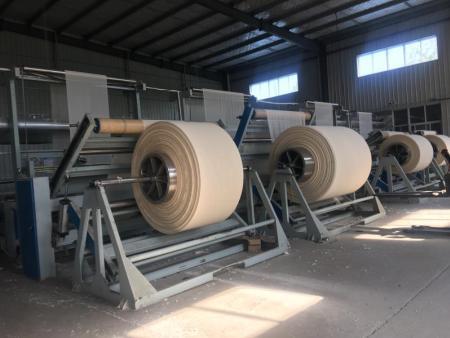 北京打卷机厂商_东奇船舶提供好的坯布打卷机