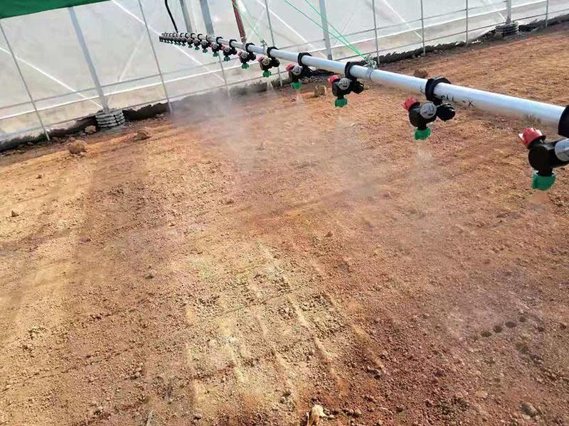 双轨温室喷灌机-温室喷灌机加工-温室大棚洒水车厂家
